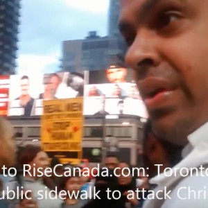 Security Guard Rushes Sidewalk To Stop Preacher From Islam Criticism